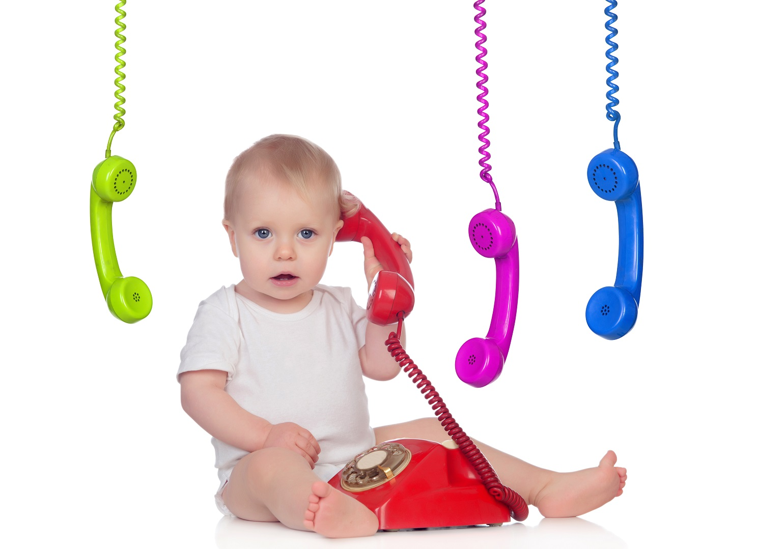 Beautiful baby with many telephones isolated on a white background